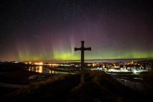 Northumberland, England The northern lights over St Cuthbert's Cross in Alnmouth