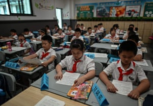 Studens attend to their class in Changchun Street Primary School in Wuhan, 4 September during a media visit organised by local authorities.