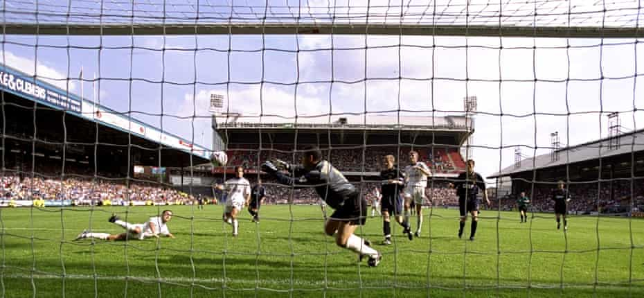 The Wimbledon keeper Neil Sullivan saves from Chelsea's Dennis Wise in the Premiership in August 1999 in front of a crowd of 22,167 at Selhurst Park
