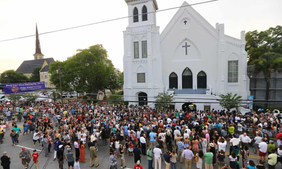 Hundreds of people stream from a public memorial, community prayer and healing vigil at the College of Charleston for those killed at the Mother Emanuel AME church on Friday.