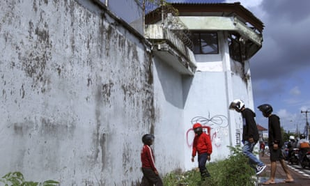 Residents observe a hole on the ground through which four foreign inmates escaped from Kerobokan prison in Bali, Indonesia.