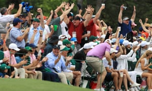 Patrons celebrate Tiger Woods's putt for birdie at the 16th hole in the final round of the Masters in 2019.
