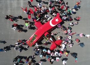 People gather to celebrate Semin  Öztürk, Turkey's first professional female aerobatic pilot