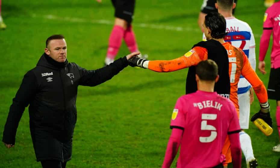 Wayne Rooney celebrates Derby's win at QPR in January with his goalkeeper Kelle Roos.