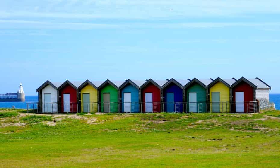 Colourful beach huts at Blyth, Northumberland, UK.