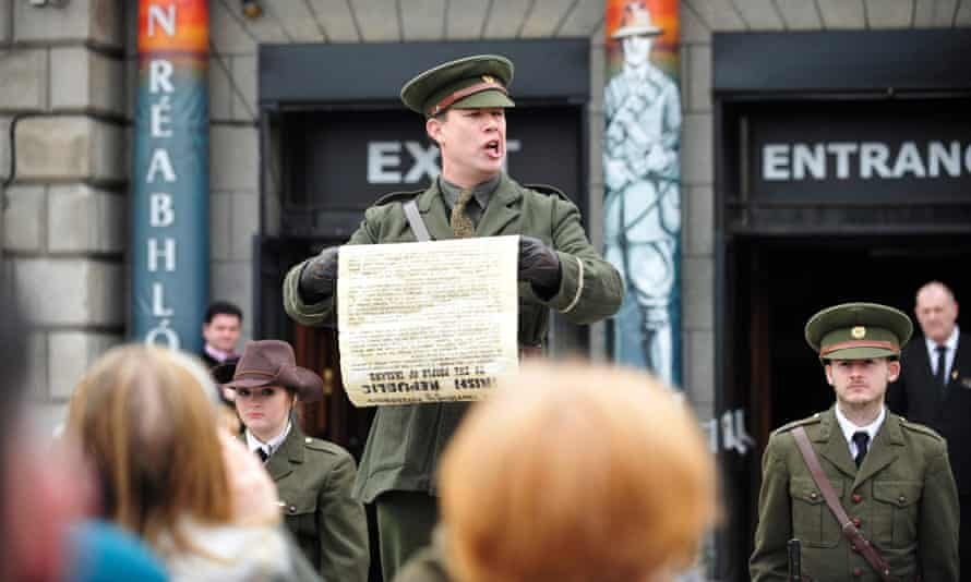 An actor posing as Irish rebel leader Patrick Pearse reads the 1916 proclamation to tourists in Dublin.