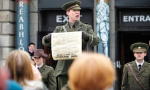 An actor playing Patrick Pearse reads the 1916 Proclamation to tourists in Dublin