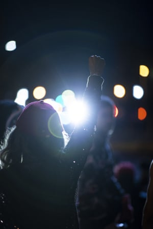 A protestor raises their fist as the group stands off with police officers on May 30, 2020 in Louisville, Kentucky. Protests have erupted after recent police-related incidents resulting in the deaths of African-Americans Breonna Taylor in Louisville and George Floyd in Minneapolis, Minnesota.