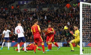 Marcus Rashford of England curls the ball into the net to make the score 4-0.