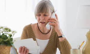A woman looking worried about paying bills