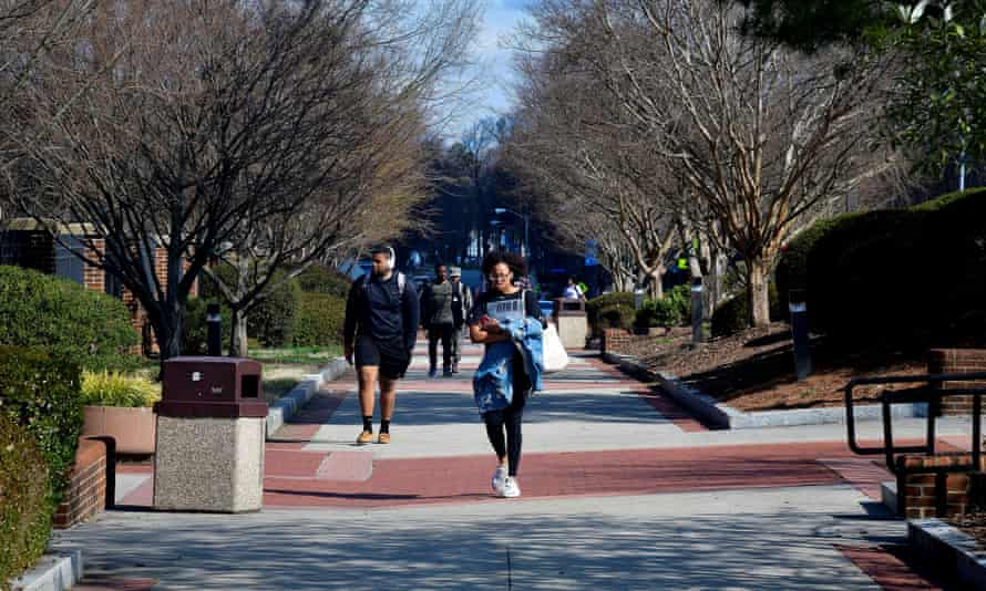 Students walk at North Carolina A&T University along the line that divided congressional districts 13 and six on campus in Greensboro, North Carolina, in 2019.