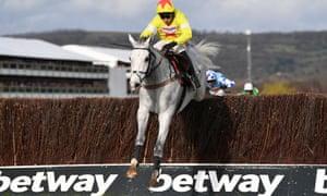 a jockey jumps a hurdle emblazoned with the Betway logo
