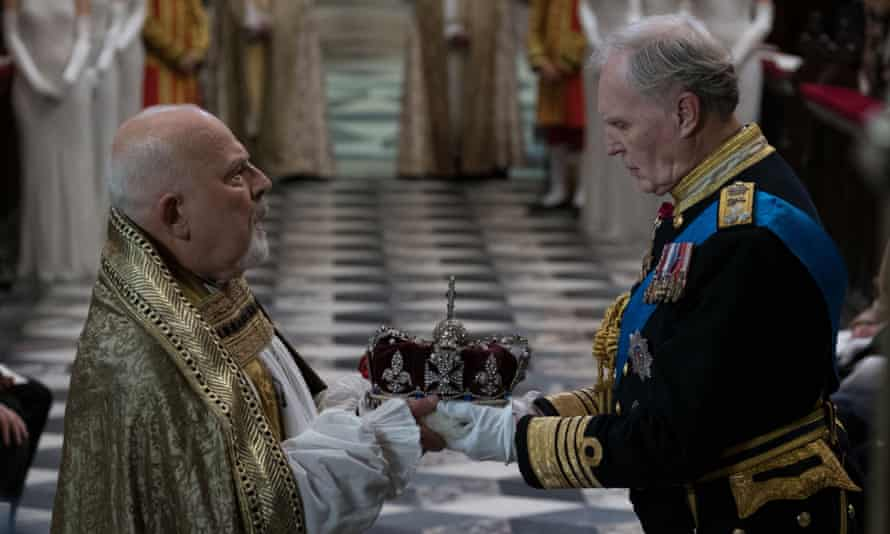 King Charles III receives his crown from the archbishop. The monarch is played by Tim Pigott-Smith, who died last month.
