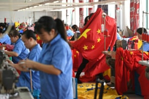 Workers making Chinese flags at a factory ahead of the 70th founding anniversary of People's Republic of China, in Jiaxing, Zhejiang province, China, yesterday