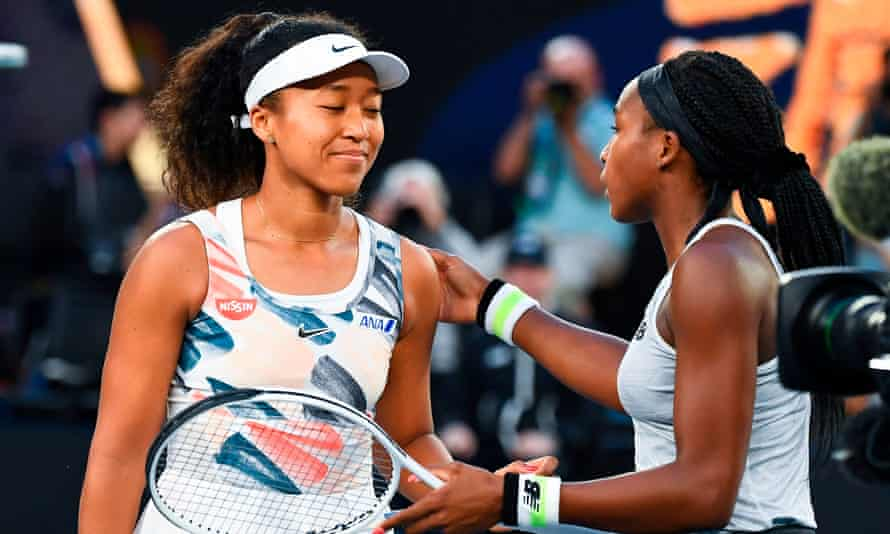 Coco Gauff greets a dejected Naomi Osaka at the end of their women's singles match on day five of the Australian Open.