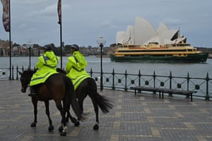 Sydney, Australia. Police on horseback ride past Sydney Opera House after Covid stay-at-home orders were lifted in New South Wales
