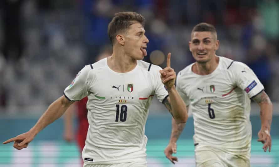 Italy's Nicolò Barella (left) and Italy's Marco Verratti celebrate Barella's opening goal against Belgium.