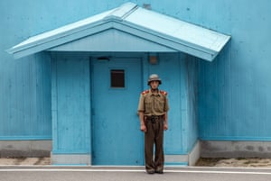 A North Korean soldier stands guard on the North Korean side of the Joint Security Area in the demilitarised Zone.