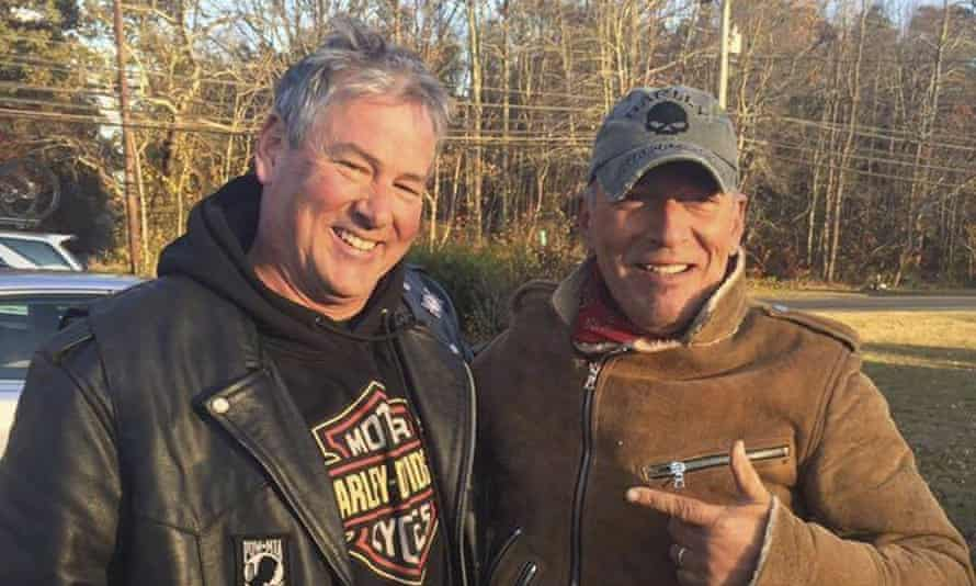 Dan Barkalow, left, and Bruce Springsteen pose for a picture after the biker helped the rock star when he was stranded on a road in New Jersey.