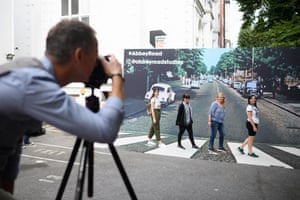 London, UK: Fans pose against a recreation of the pedestrian crossing outside Abbey Road studios