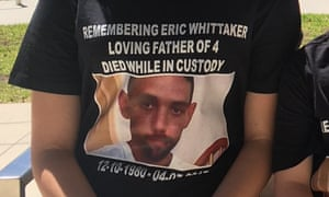 A family member of Eric Whittaker wearing a t-shirt with his photo.