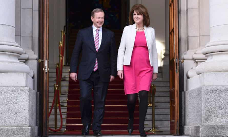 Enda Kenny with Joan Burton, the deputy prime minister and Labour party leader, after announcing the general election in Dublin