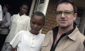 Bono with a young patient at a health centre in Rwanda in 2006.