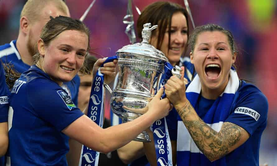 Erin Cuthbert and Ramona Bachmann celebrate with the trophy after Chelsea won the FA Cup for the second time.