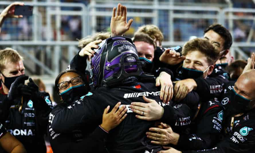 Lewis Hamilton embraces his Mercedes team after sealing a stunning win at the Bahrain Grand Prix.