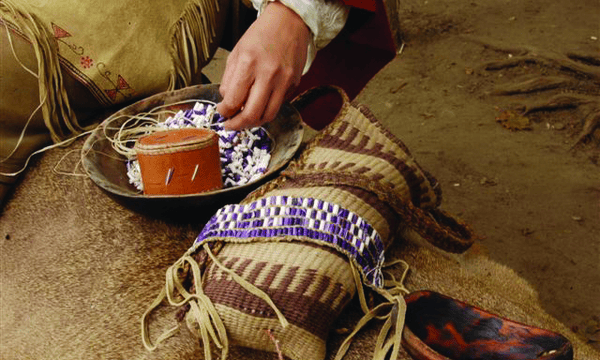 A member of the Wampanoag nation working on the new wampum belt.