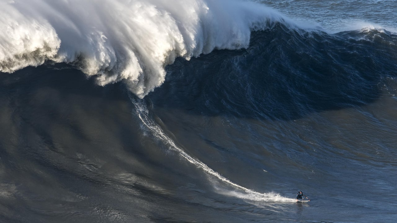 Giant Wave Slams Into British Surfer Andrew Cotton Causing Huge - Guys sets himself on fire before surfing a huge wave