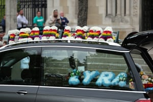 The hearse with floral tributes outside St Anne's Cathedral