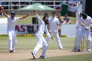 England's bowler Moeen Ali, centre, celebrates after dismissing South African batsman Kyle Abbott.