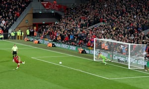 James Milner of Liverpool scores their first penalty.