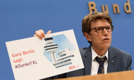 Engelbert Luetke-Daldrup, head of BER airport, holds a sign reading 'All of Berlin says: #Thanks TXL' as he addresses a news conference in Berlin on 29 September.