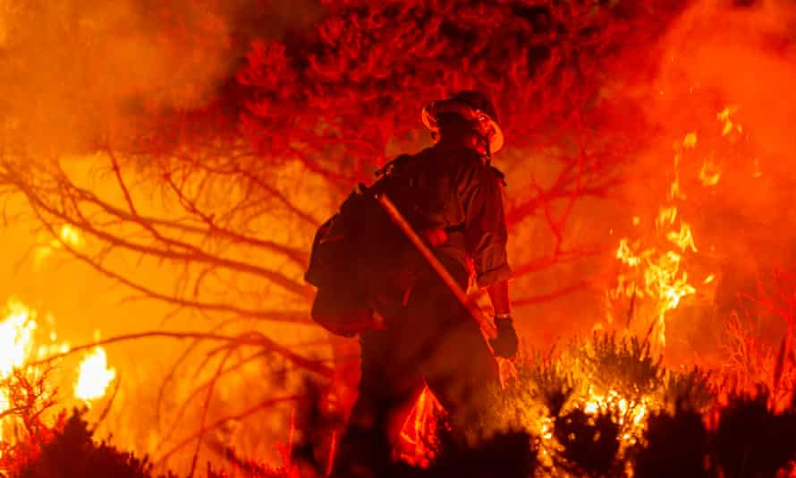 Firefighters battle the Bobcat fire as it surpasses 100,000 acres on the evening of 20 September near Wrightwood, California.