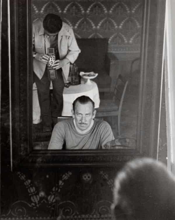 Robert Capa photographing John Steinbeck through a mirror, 1947