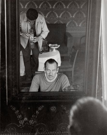 Robert Capa photographing John Steinbeck through a mirror, 1947