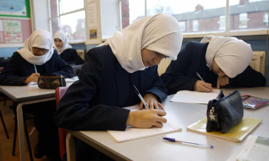 Muslim schoolchildren in an English class
