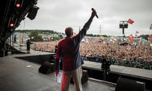Labour Party leader Jeremy Corbyn addresses the crowd from the Pyramid Stage at Glastonbury festival.