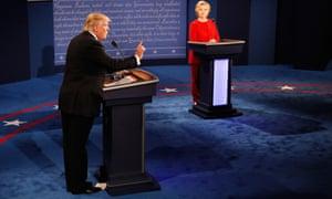Trump speaks as Clinton listens during the debate at Hofstra University Monday.