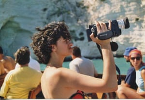 Katthy Cavaliere holding a camcorder. The pioneering feminist artist died at the age of 40.