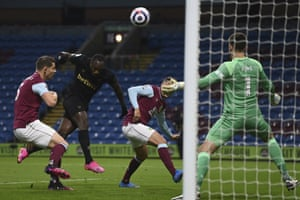 West Ham's Michail Antonio, second left, heads the ball to score his side's first goal.
