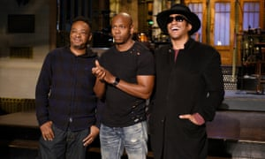 Jarobi White and Q-Tip of musical guest A Tribe Called Quest pose with host Dave Chappelle on Saturday Night Live