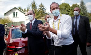 France's prime minister, Jean Castex, and the race director, Christian Prudhomme, at Saturday's stage of the Tour de France