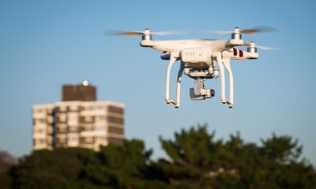 A drone flying near a block of flats