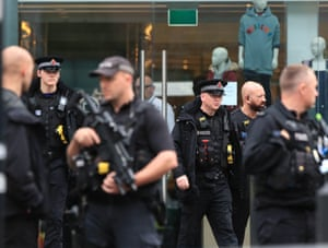 Manchester, UK Armed police officers outside the Arndale centre where at least five people have been treated after a stabbing incident