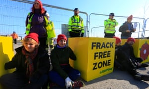 Campaigners block the entrance to the Preston New Road fracking site in Lancashire, after the government overruled the local council decision to reject planning permission.