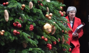 Theresa May outflanked by a rogue Christmas tree at Downing Street this week.