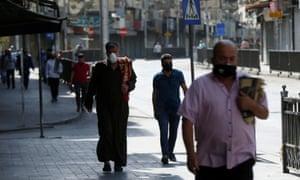 Mask wearers on the street in Amman.